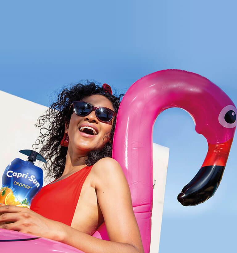 woman enjoying Capri-Sun 330ml orange