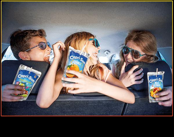 Kids in a car enjoying Capri-Sun Monster Alarm